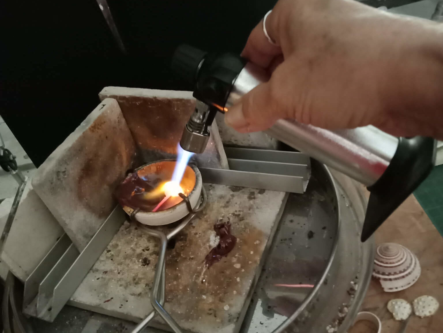 Heat from a small butane kitchen torch, is intensified using heat blocks in a corner configuration.
